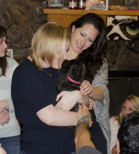 New interns Lauren Dafoe and Lee Rodriguez make a new friend at the going away party for the outgoing intern class.