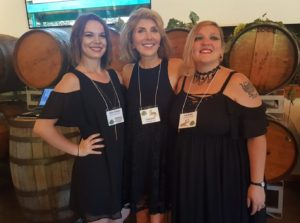 Three communications ladies at Sipping for Sanctuary